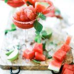 Watermelon slush in a stemmed glass.