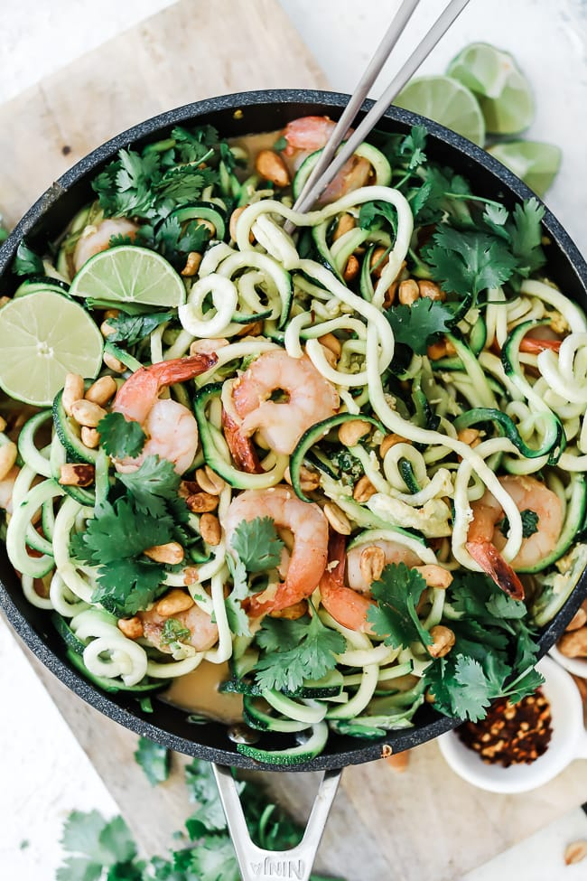 A close up of zoodles shrimp pad Thai recipe in a non stick skillet.