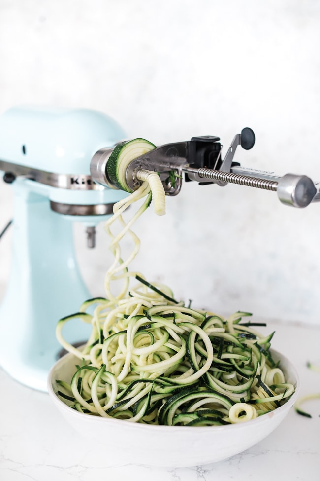 Preparing zucchini noodles with the Kitchenaid spiralizer attachment.