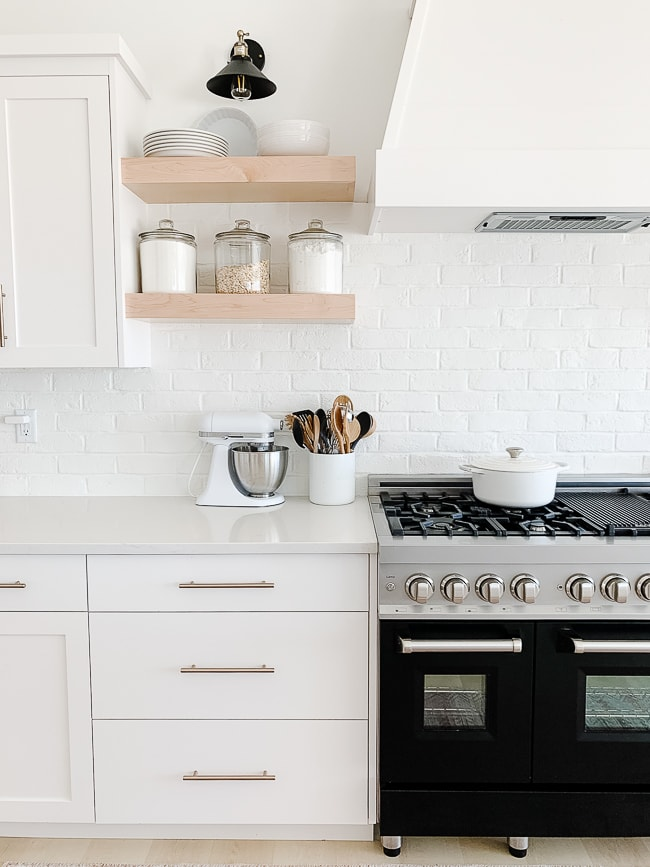 black stove next to white cabinets