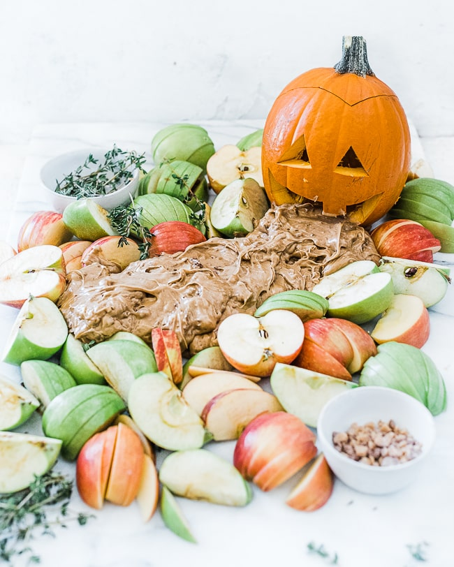 Toffee apple dip styled with a jackolantern vomiting it.