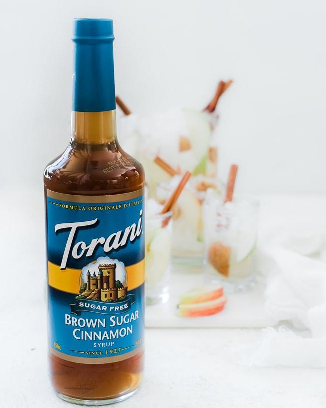 A close up shot of Torani bottle of brown sugar cinnamon syrup.