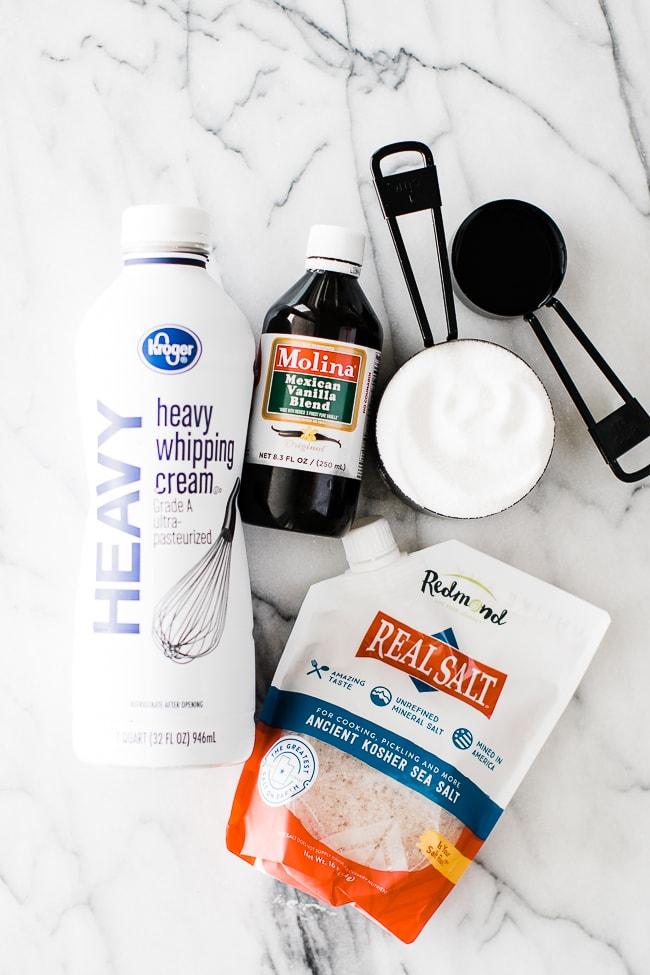 ingredients for salted caramel sauce- cream, vanilla, butter, sugar salt
