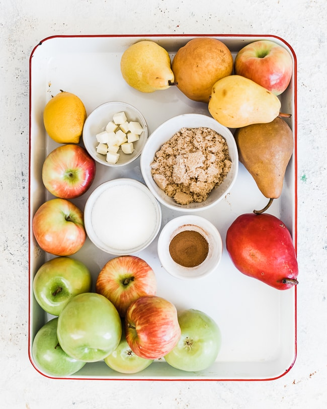 Ingredients needed for apple slab pie on a baking sheet.