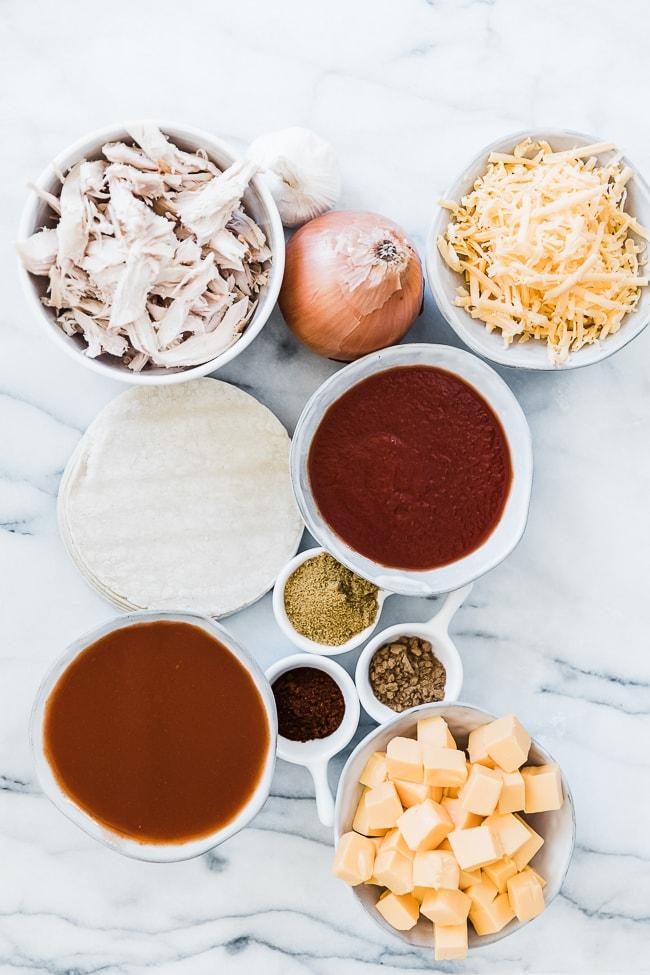 Ingredients needed to make chicken enchilada soup.