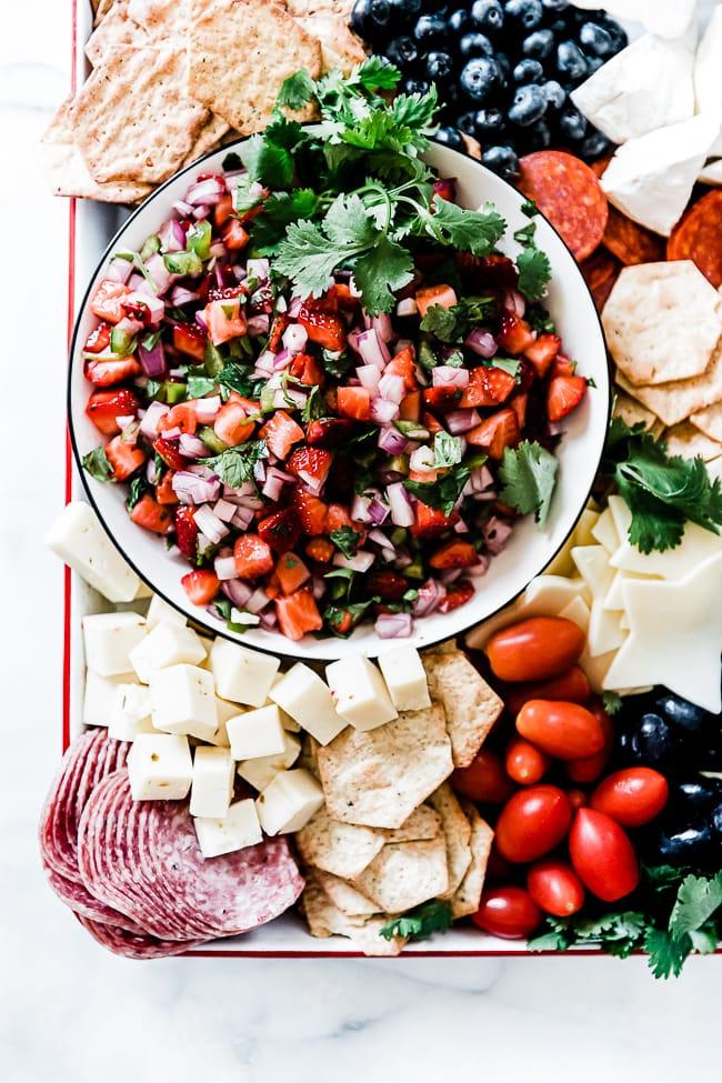 Strawberry salsa on a charcuterie board.