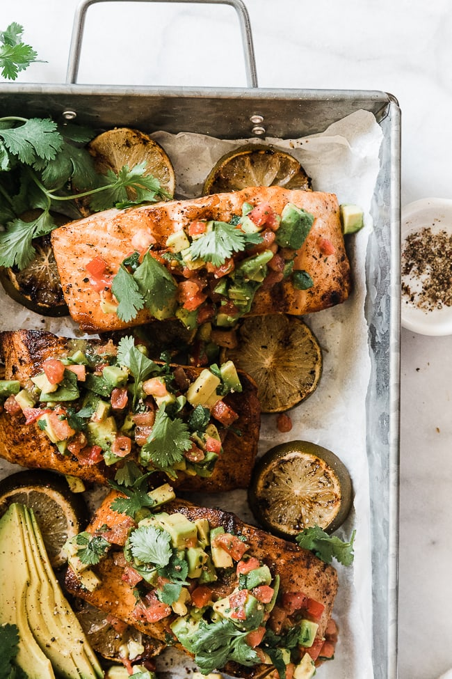 An overhead close up on avocado salmon in a metal pan.