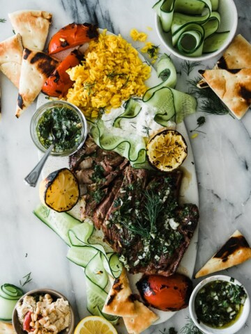 platter of lamb with chimichurri sauce and rice