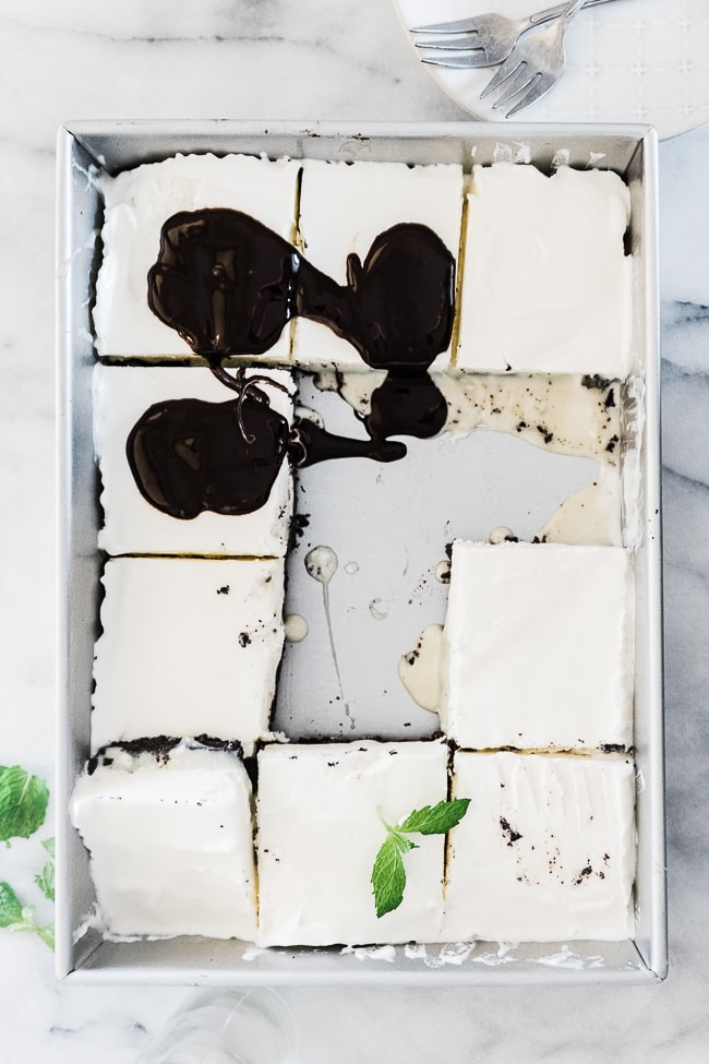An overhead view of mud pie recipe in a pan. It is cut into squares.