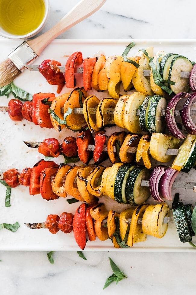 A close up of grilled vegetable kabobs.