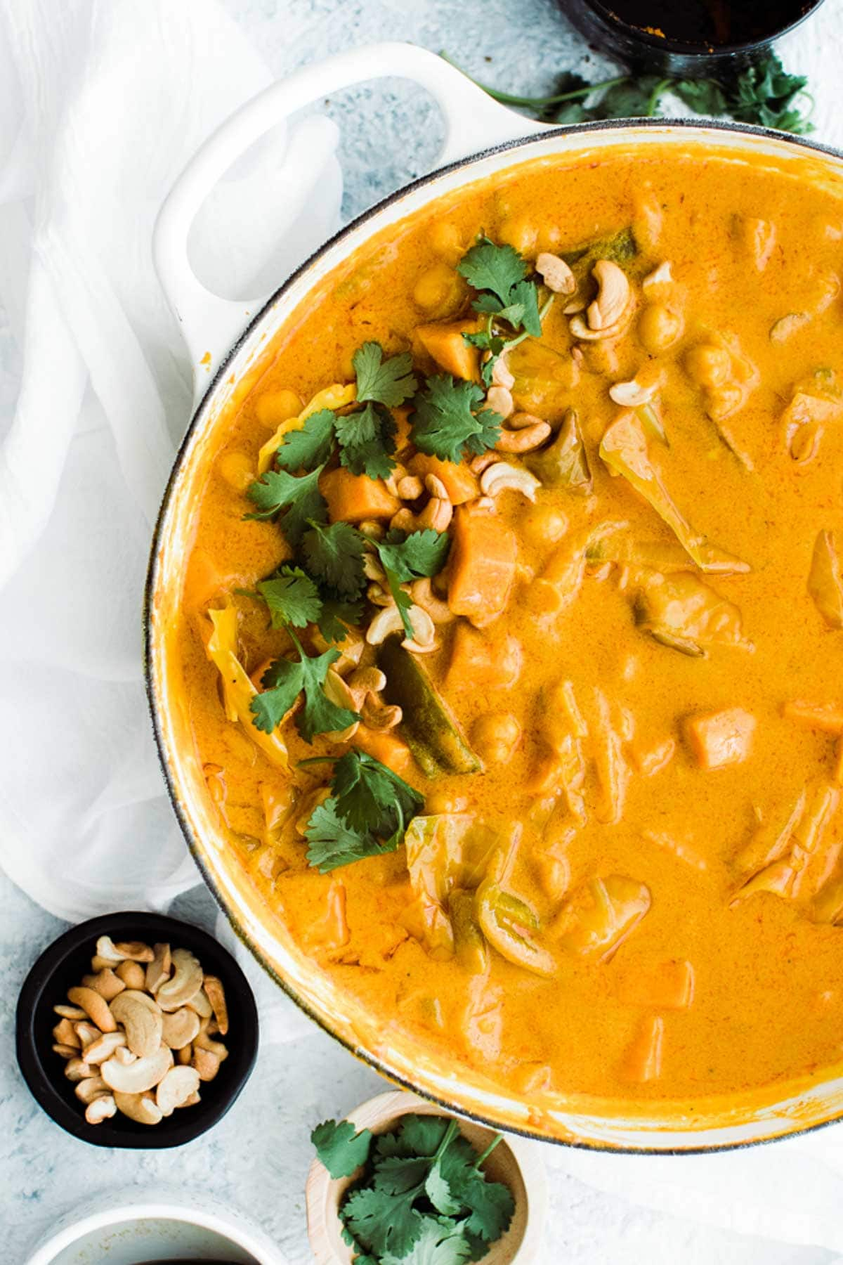 pumpkin curry simminering in pan with cilantro on top