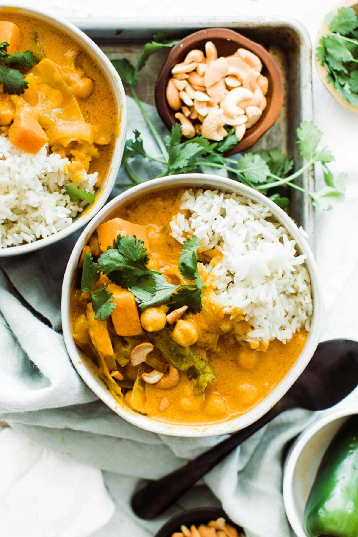 Bowl of pumpkin curry, rice and cilantro on top